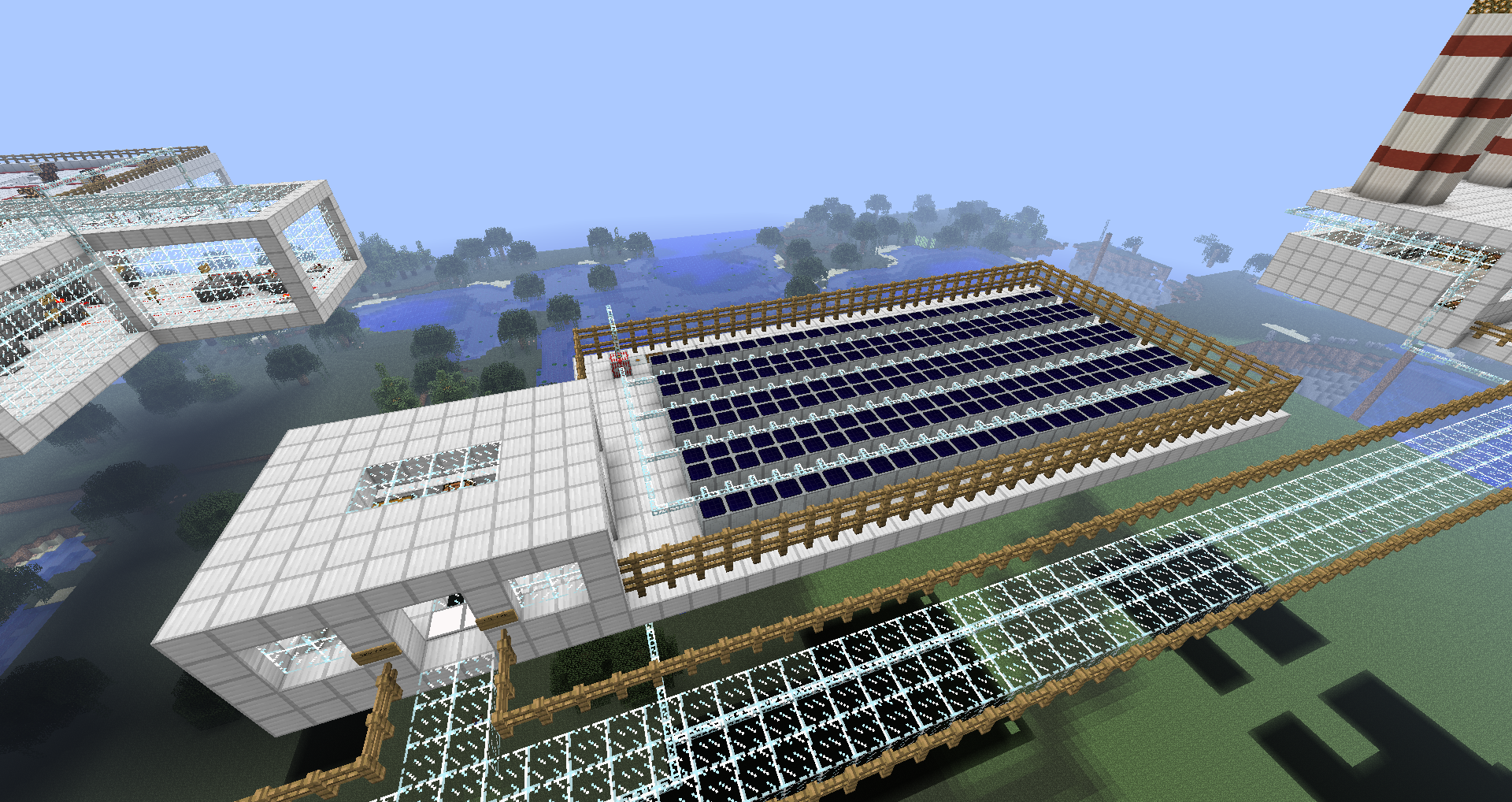Overview of the solar plant showing several rows of solar cells feeding into the building.